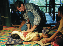 Dr François Nosten treating a sick child at the Mae La refugee camp.